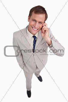 Close up of smiling businessman scratching his head