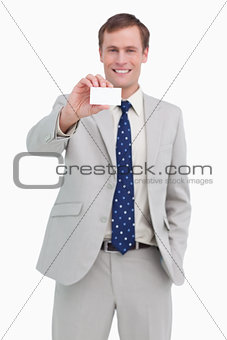 Smiling businessman presenting his business card