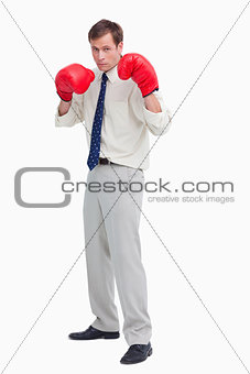 Businessman with his boxing gloves ready to fight