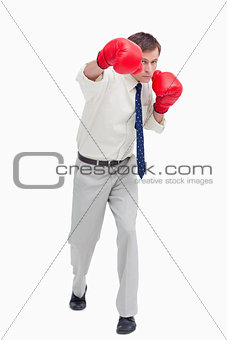 Businessman attacking with boxing gloves