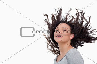 Sensual looking woman flipping her hair