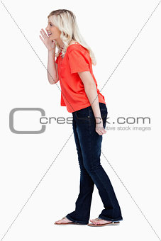 Side view of a teenager girl calling for someone