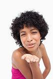 Smiling woman sending a kiss in front of the camera