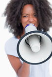 Megaphone held by a young woman shouting