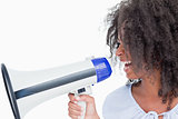 Young woman talking into a megaphone