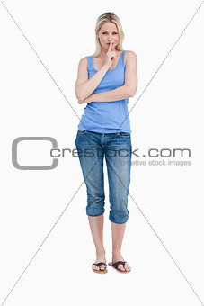 Blonde woman telling to be quiet while crossing her arms