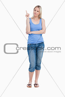 Blonde woman raising her finger while crossing arms