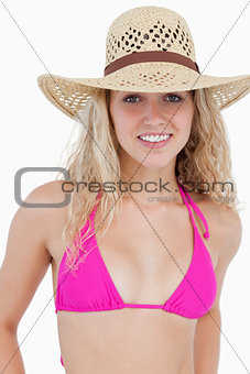 Smiling attractive teenager in beachwear standing upright