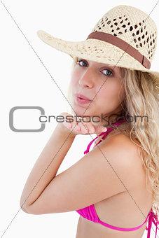 Attractive woman sending an air kiss