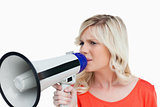 Young blonde woman speaking into a megaphone