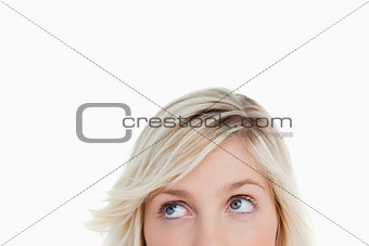 Blonde woman's eyes looking up
