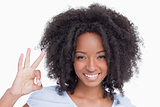 Young woman making the OK sign while smiling