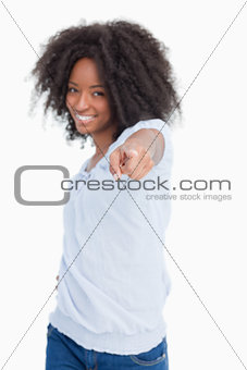 Young woman pointing her finger while laughing
