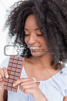 Young woman looking at a delicious chocolate bar