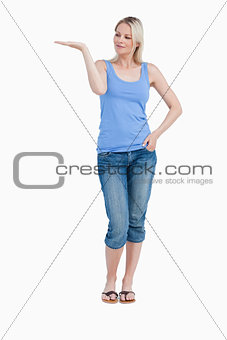 Blonde woman looking at her right hand palm up