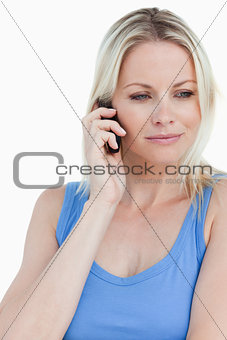 Relaxed blonde woman talking on her mobile phone