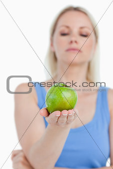Beautiful green apple held by a blonde woman