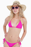 Attractive blonde teenager wearing a swimsuit with a hat and sun