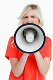 Woman looking upset while speaking into a megaphone