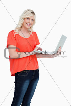 Smiling woman looking straight at the camera while holding a lap