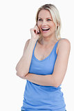Blonde woman using a cellphone while laughing