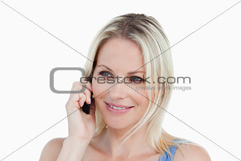 Smiling blonde woman using her cellphone