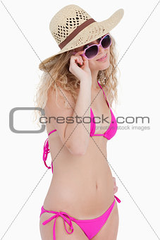 Attractive blonde teenager looking over her sunglasses