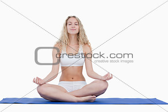 Young attractive woman doing yoga in sportswear