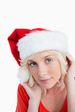 Young blonde woman wearing the Santa Claus hat
