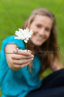 Beautiful white flower held by an attractive young woman
