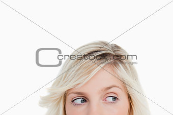 Eyes of a young blonde woman looking on the side