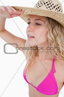 Attractive blonde woman trying to look far to the side