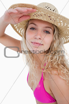 Attractive blonde teenager trying to look far ahead