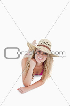 Smiling teenager lying down with her legs crossed
