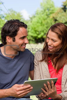 A man and a woman look into each others eyes while they are hold