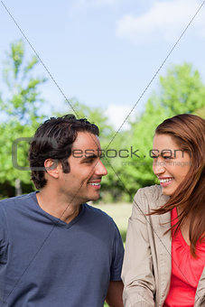 Two friends smiling as they look into each others eyes