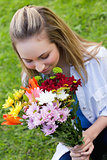 Young attractive girl smelling a bunch of flower