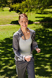 Woman smiling while jogging