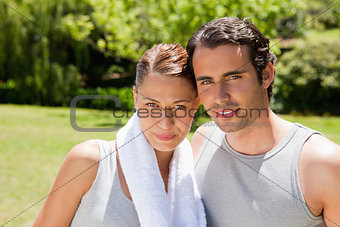 Woman and a man standing together in workout gear