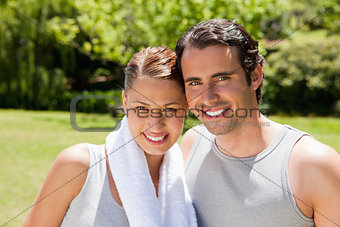 woman with and man smiling in workout gear