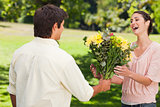 Man presents his friend with flowers