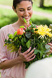Woman looking at flowers which have been given to her