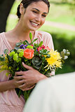 Woman holding flowers which she has been given