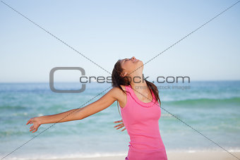 Young woman sunbathing on the beach