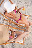 Overhead view of young women sitting on the beach