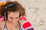 Smiling young woman listening to music with her headset
