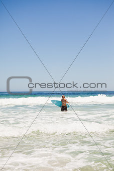 Young blonde man returning to the beach