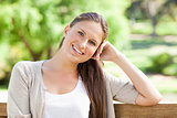 Smiling woman enjoying her day on a bench