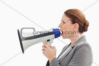 Businesswoman talking into megaphone