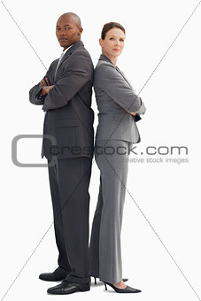 Business man and woman stand back to back